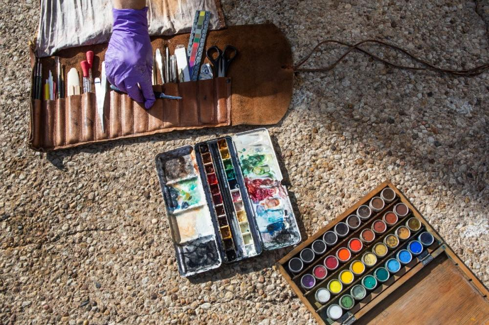 Pigments and conservation tools laid out for detailed work on one of Landmarks' outdoor sculptures.