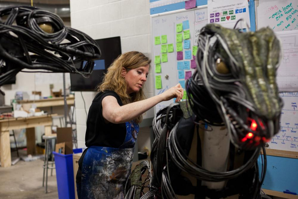Karen Maness working on a raptor in the work shop