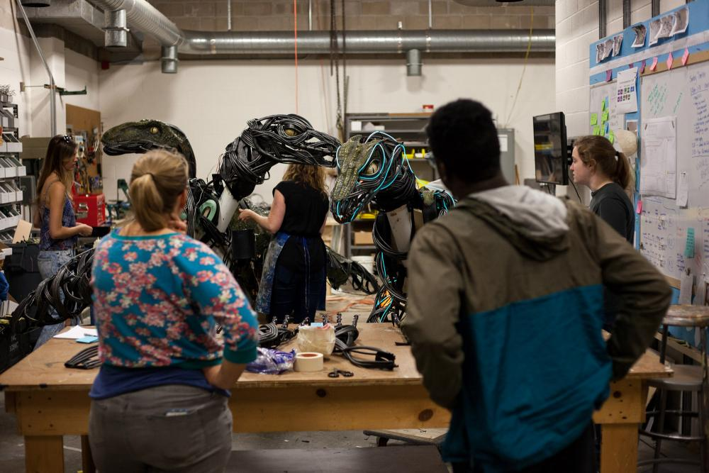 an image of students working on making animatronic raptors in a work shop