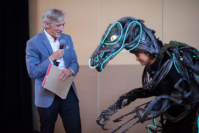 Dean Dempster with a raptor puppet from the play Enron