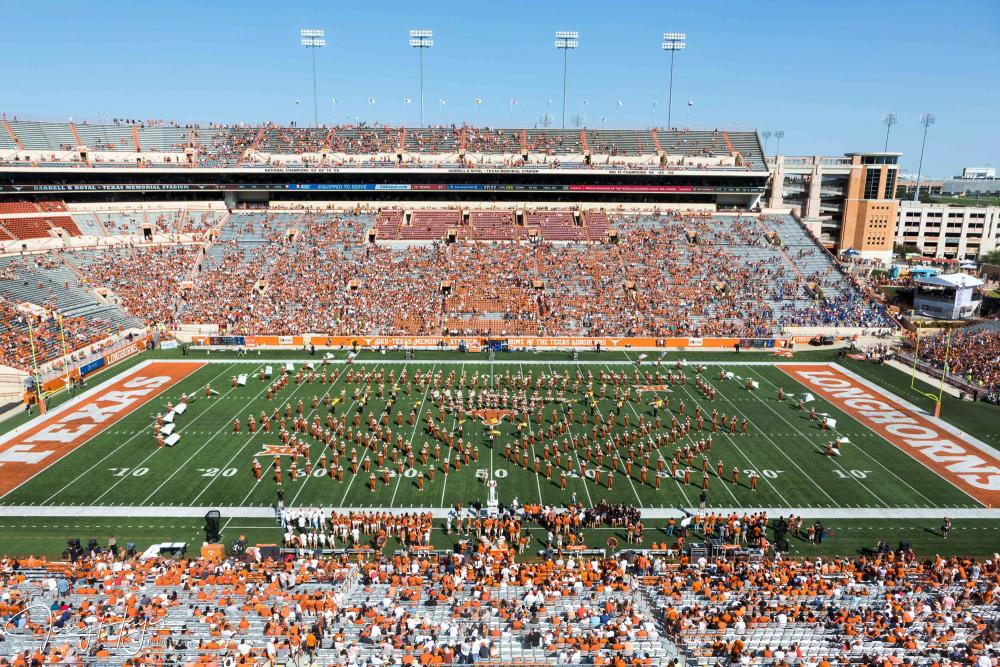 the UT Longhorn band performing a halftime show in the Darrell K Royal-Texas stadium