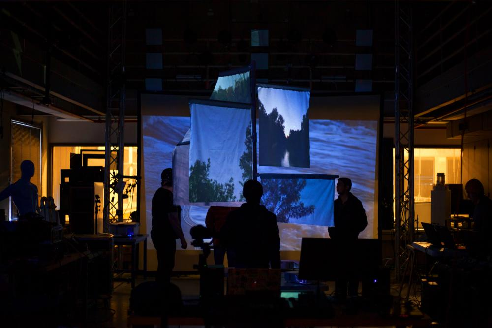 Students display a projected exhibition of nature seen through windows