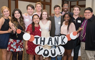 "Scholarship recipients with ""thank you"" banner"