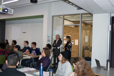 Dean Doug Dempster and Jan Ryan look on as students participate in 3 Day Startup.