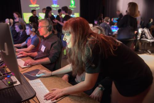 Jenna Wright demonstrates her game at Digital Demo Day. Photo by Sandy Carson.