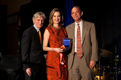 Kimbell Wynne accepting the E. William Doty Award with Dean Douglas Dempster and Professor Jeffrey Chip Smith