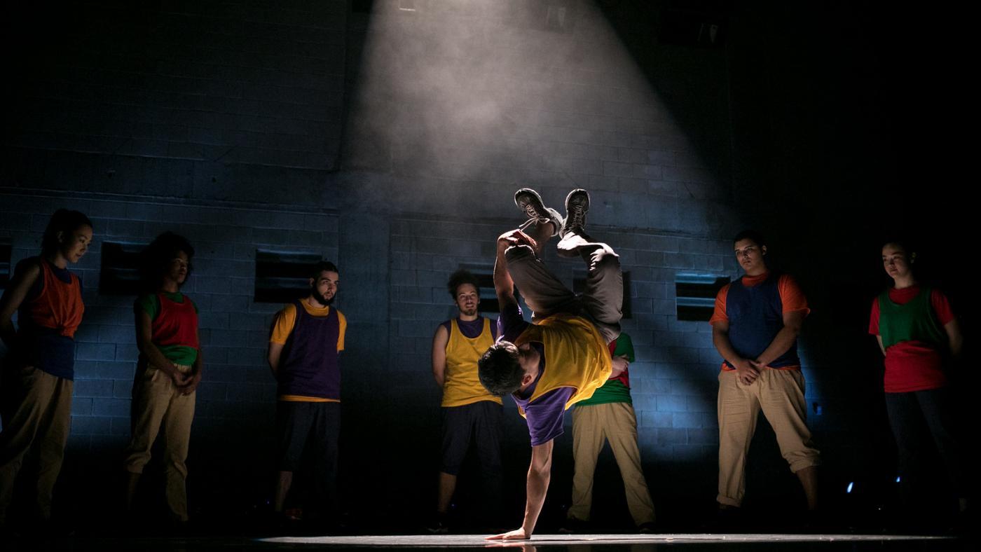 A dancer performs choreography for a hip hop piece