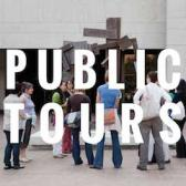 People standing in front of a sculpture