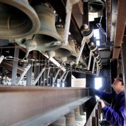 Austin Ferguson looking at a carillon