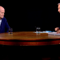 Chris Ware sits across a table from Charlie Rose