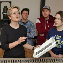 Leah Dyjak teaching students in a photography lab