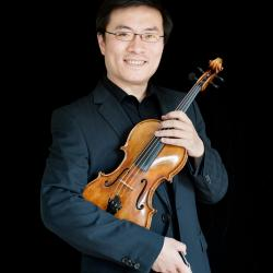 Wei He poses with a violin