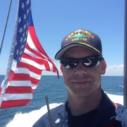 Cmdr. Jason Pittman during a command-change ceremony onboard the USS Helena.