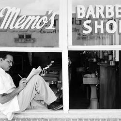 A man sits in a windowsill in a famous photo by Russell Lee.
