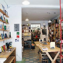 An art installation with books, seating and plants.