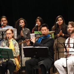 Singers and musicians from the U.S. and Pakistan on stage