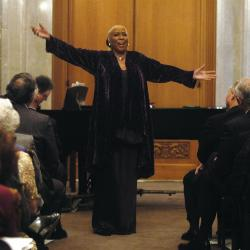 Barbara Smith Conrad gestures with her arms to a crowd