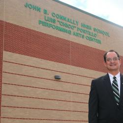 Luis Portillo poses in front of the facility named in his honor.