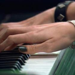 Artwork by Teresa Hubbard featuring hands playing a piano