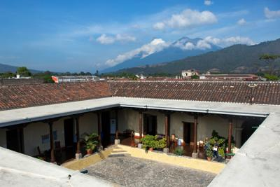 a view of volcanos and Casa Herrera courtyard, from the rooftop of Casa Herrera in Guatemala