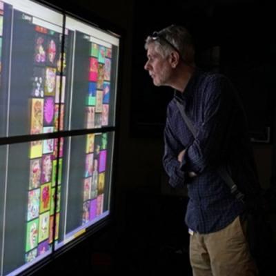 a man looking at video screens
