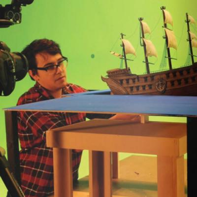 a student works on a special effects project of a boat
