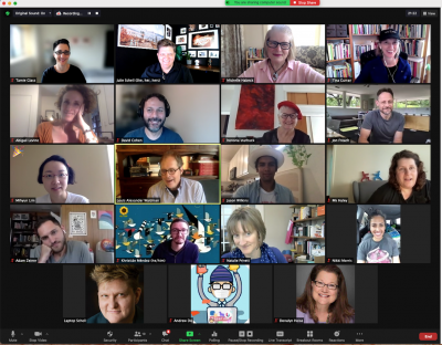 A Zoom grid of participants faces, photos and video feeds