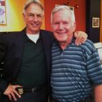 James Walters poses for a photo next to Mark Harmon