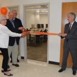 The Goyanes cut the ribbon on a remodeled photo lab.