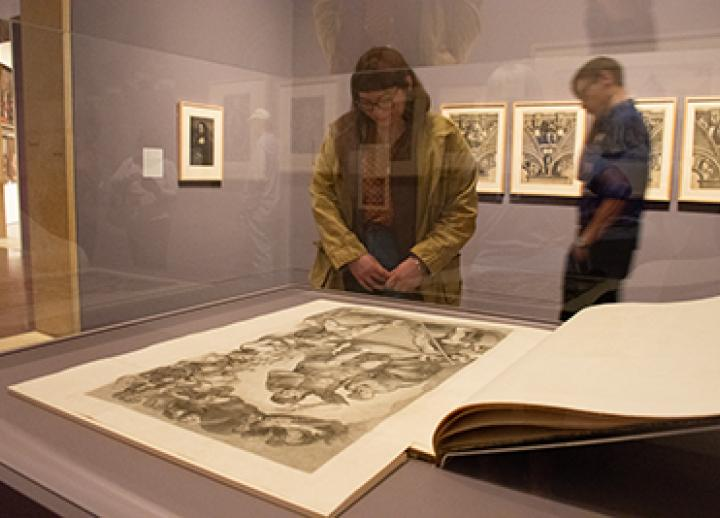 An art history student views a book on view at the Blanton Museum of Art.