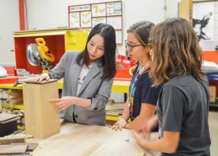 Design Professor Jiwon Park works with students in the design program.