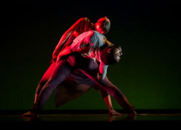 Two students in the B.F.A. in Dance program perform onstage