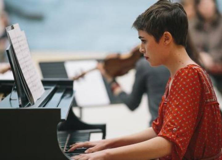 A student in the composition program plays the piano.