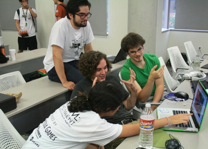Team Baby Giants with Pricilla Delatorre (Studio Art), Adam Mansfield (Mathematics), Corben Marroquin (Studio Art) and Russell Jahn (Computer Science) with their game at the 24-hour Game Jam event in 2013. Photograph by Michael Baez.