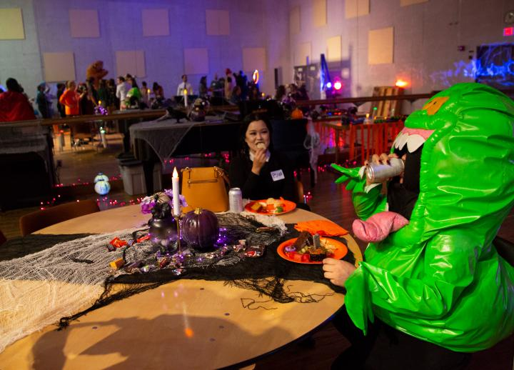 Two staff members in costume at an event organized for Halloween by the College of Fine Arts Staff Council