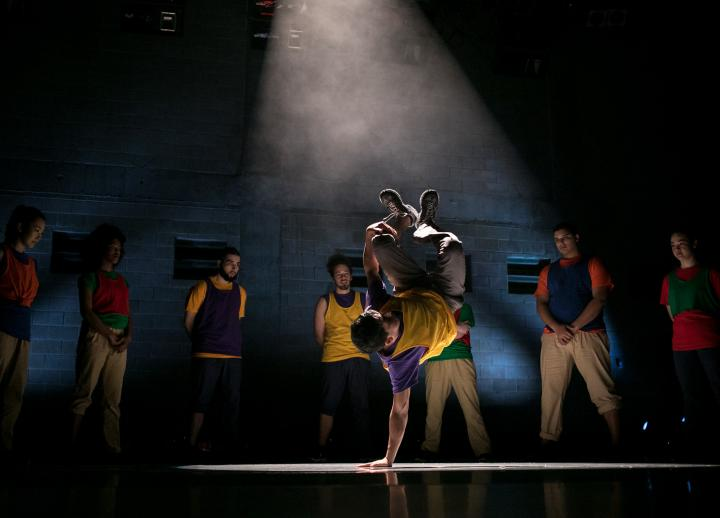 A dancer performs choreography for a hip hop piece