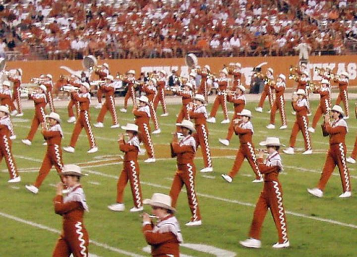 Texas longhorn band piccolo players on the field