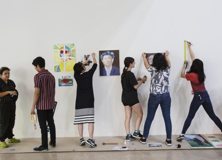 Youth hang their work in the Visual Art Center galleries as part of Summer ST.ART.
