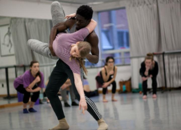 Two students in the UTeach Dance program rehearse.