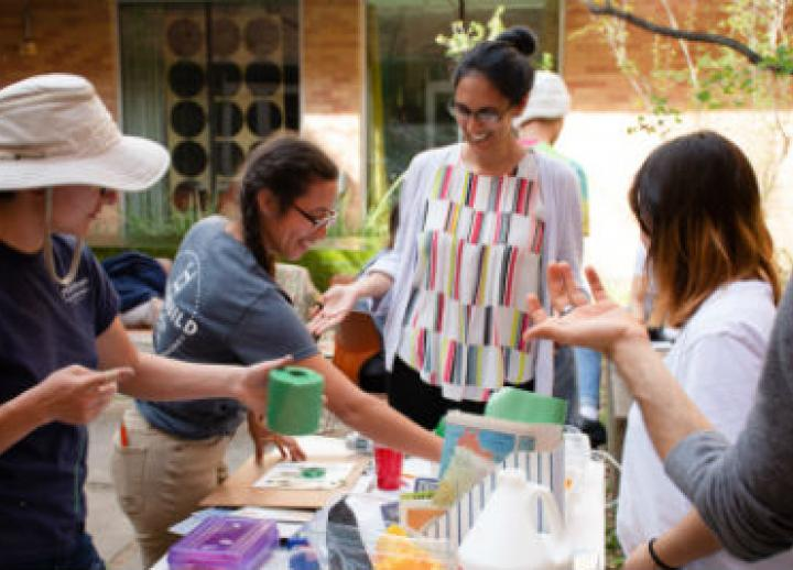 Art Education students work with youth on art projects outside the Blanton Museum of Art.