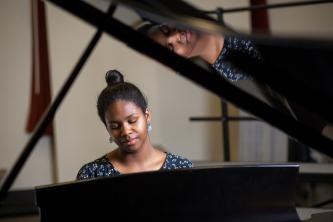 Jocelyn Chambers plays a grand piano