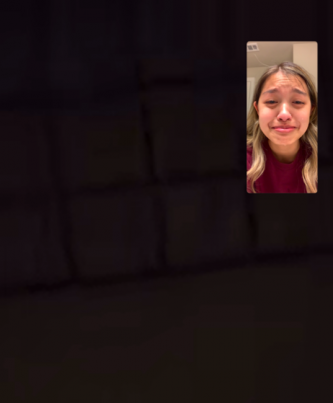 A screenshot of a student Facetiming her roommate about Professor Waldman.